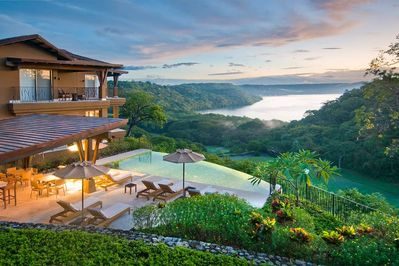 Overview of Vista Hermosa next to the infinity edge pool and views of Bahia Culebra, jungle, and golf course .