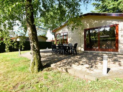 Photo for Detached chalet with private jacuzzi and garden in quiet park at the edge of the Veluwe