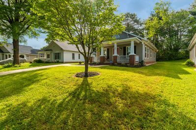 Nicely, simple front yard with covered porch.