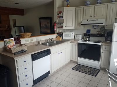 Photo for 4 level townhome is steps away from base of ski slopes.  3 Full bathrooms, wood