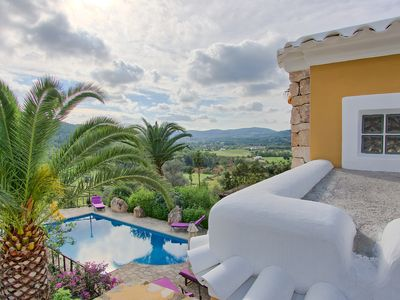 Photo for Typical stone 250 years old ibizan country villa with pool facing sunset.