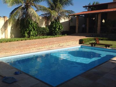 Photo for Fontes Beach mansion, 04 quarters, 100 m from the beach, deck with BBQ