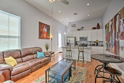 The open floor plan is teeming with vibrant art & modern finishes.