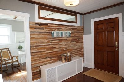 Original lath from old kitchen wall was repurposed for accent wall in entry way
