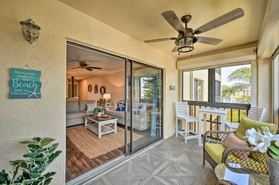 Soak up the sea breeze in this Fort Myers vacation rental's 4-season sunroom.