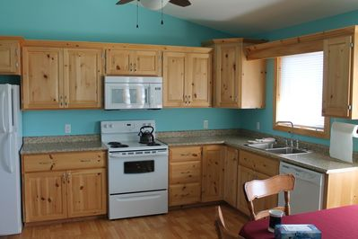 Bright eat-in kitchen with easy access to the front and side deck
