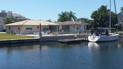 Beautiful home on canal just off the Gulf. Pool and large dock.