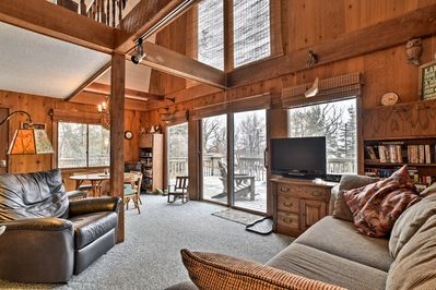 This vacation rental cabin is located on School Section Lake!