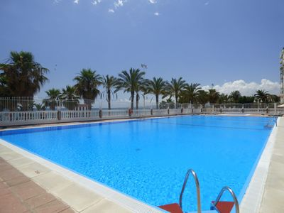 Photo for Apt. In beachfront with sea views, swimming pools, tennis, internet