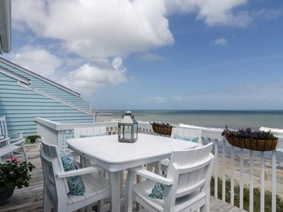 Photo for Upgraded oceanfront condo with expansive outdoor deck to relax with family