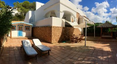 Photo for House with garden little sea view in IBIZA WIFI  with community swimming pool