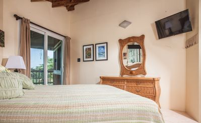 Upstairs bedroom looking towards outside balcony with ocean views.