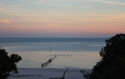 December sunset taken by our recent guest,Crystal. Beautiful walk on the beach!!