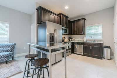 Enjoy a brand new fully equipped kitchen with stainless steel appliances.