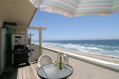 BBQ, chairs, umbrella and table on private deck. What a view!