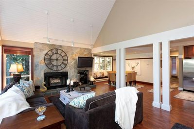 Spacious, open concept living room, dining room and deluxe kitchen flow together seamlessly; perfect for entertaining