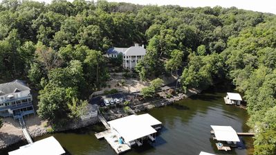 Photo for Beautiful home on 8 acres, 450' of lakefront & private dock on a no wake cove