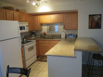 Kitchen featuring granite counters