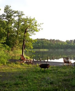 Photo for Right on the lake - plenty of space for family & friends, modern, terrace, boat rental
