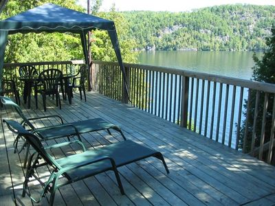 Large deck; faces East.  Papineau Labelle Reserve in front; therefore no neighbors facing you.