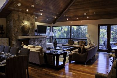 A spacious Great Room area with an expansive outdoor deck.