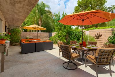 Large private courtyard with separate dining & lounge areas, each with umbrella