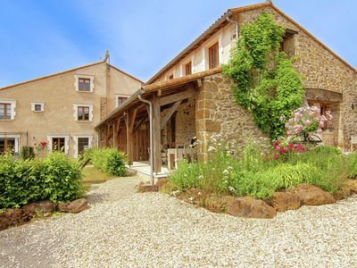 Photo for Three beautiful cottages with shared courtyard in an area with heated pool.
