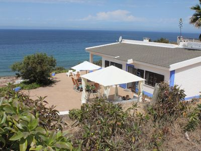 Photo for Beach house on the cliffs over the sea