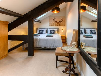 Beautiful bedroom with exposed beams