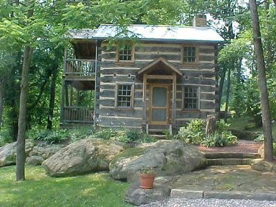 Historic log house cabin in the summer.