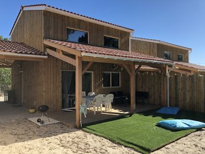 Photo for Pretty seaside wood cottage (surf & sun)