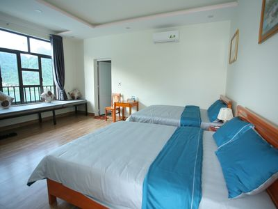 Photo for Family room with River and Mountain Views, 2 Queen Beds_Funny Monkeys Homestay