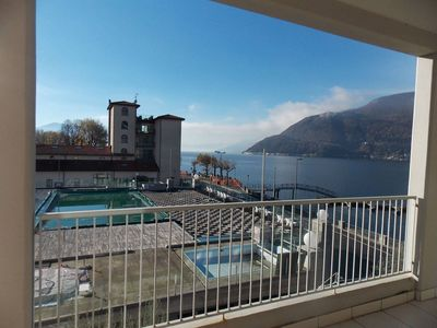 Photo for Lovely apartment with lake views, pool and jacuzzi