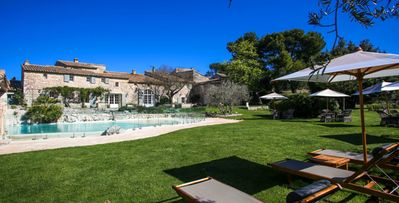 Photo for Domaine des Roches- 11 bd parkland villa with a natural rock jacuzzi in Provence