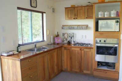 Beautifully appointed rimu kitchen
