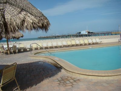 The Palms pool area with the view of the Redington Long Pier