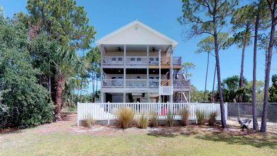 "Photo for Ready To Rent Now! FREE BEACH GEAR! Bayfront East End, Pool, Fishing Pier, Fireplace, 3BR/3BA ""Footprints In The Sand"""