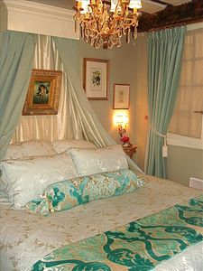 Soft shades of blue, aqua and dove gray lull you to sleep in the luxurious bed.