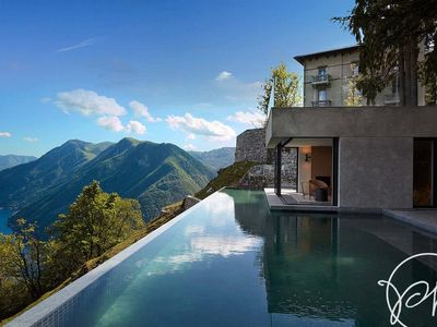 Photo for Luxurious & New Stunning Just above the Lake , with parking & boat below.