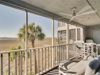 Photo for Beautifully updated condo with marsh views, balcony and a seasonal community pool.