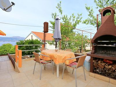 Photo for Two bedroom apartment with terrace and sea view Slatine, Čiovo (A-10368-a)