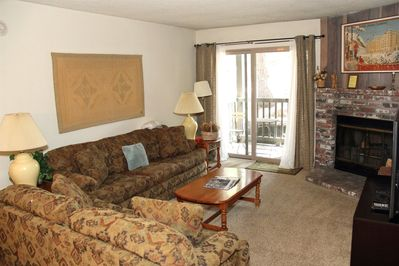 Mammoth Condo Rental Chamonix A7 - Living Room has a Large Flat Screen TV,  Queen Sofa Sleeper and Fireplace