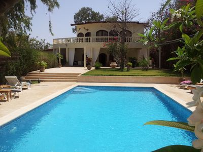 Photo for splendid villa with pool and sea views - private direct access to the beach