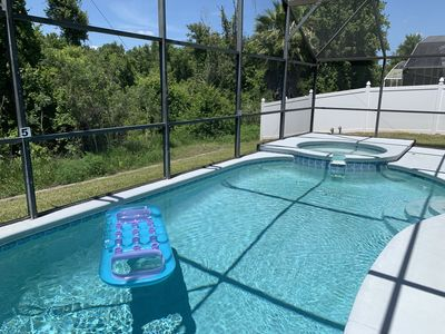 Photo for Deluxe 4 bed 3 bath pool and spa home at the prestigious Indian Creek near Disney, Orlando
