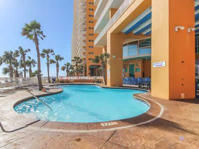 Photo for Beachfront corner condo w/ huge Gulf view & shared pools, gym & arcade!