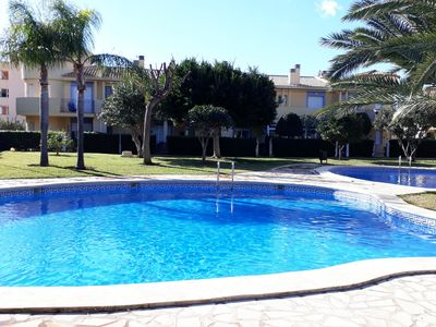 Photo for Townhouse with 4 bedrooms for 8 people with private garden and pool.