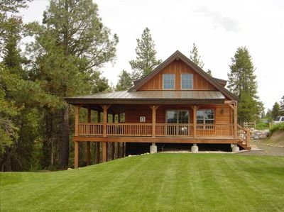 North facing view, wrap around deck and expansive lawn