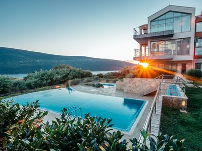 Photo for Contemporary apartments in a tranquil setting with shared infinity pool