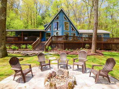 Lake access & pet friendly home w/ cozy fire pit and steamy hot tub!