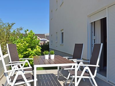 Photo for Apartment with garden / two rooms, wifi, private parking, near the beach